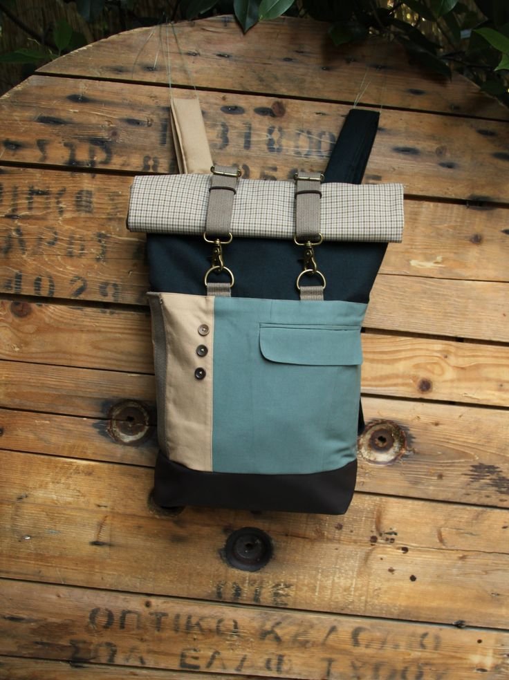 Handmade green and beige upcycled roll top rucksack using various textiles and part from a men's vintage suit , by 'eating the goober'
