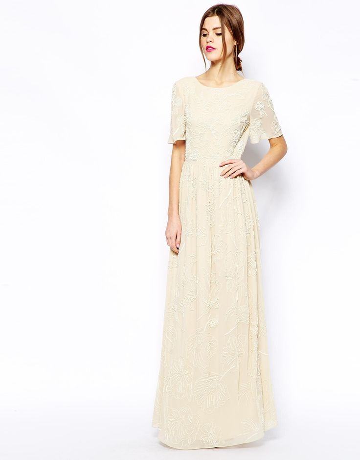 We love the vintage feel of this stunning, floral embellished maxi!