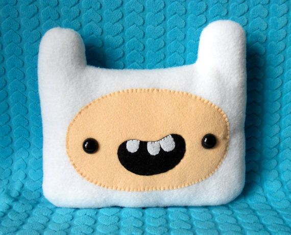 DO. WANT. THIS. PILLOW!! It's finn from adventure time!!