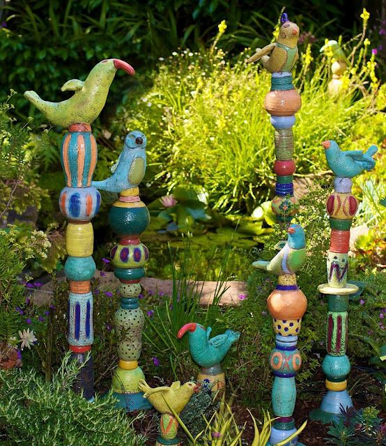 Barb Vanderbeck - totems  http://barbaravanderbeck.com HMMM...COULD BE DONE WITH PAPERMACHE CRITTERS AND BITS OF WOOD SHAPES