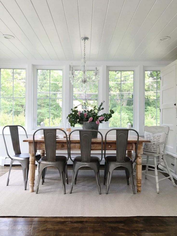 Kindred Vintage Summer Home Tour | Bright white dining space, farm table, wood floors, metal rustic industrial chairs