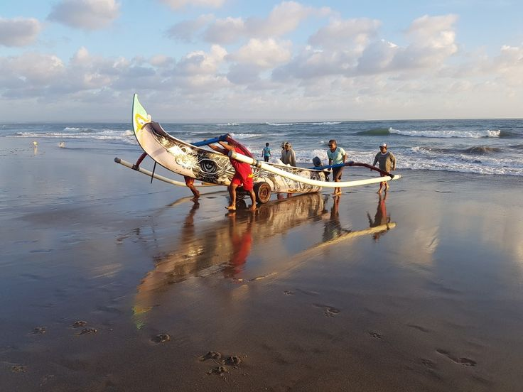 Bali during sunset fishermen coming back to the beach at Canggu with their traditional boat. Notice the beautifull artwork painted on the hull of the trimaran  First time I saw this kind of boat was through the beautifull book of Titouan Lamazou  Contact@lucpoirier.com
