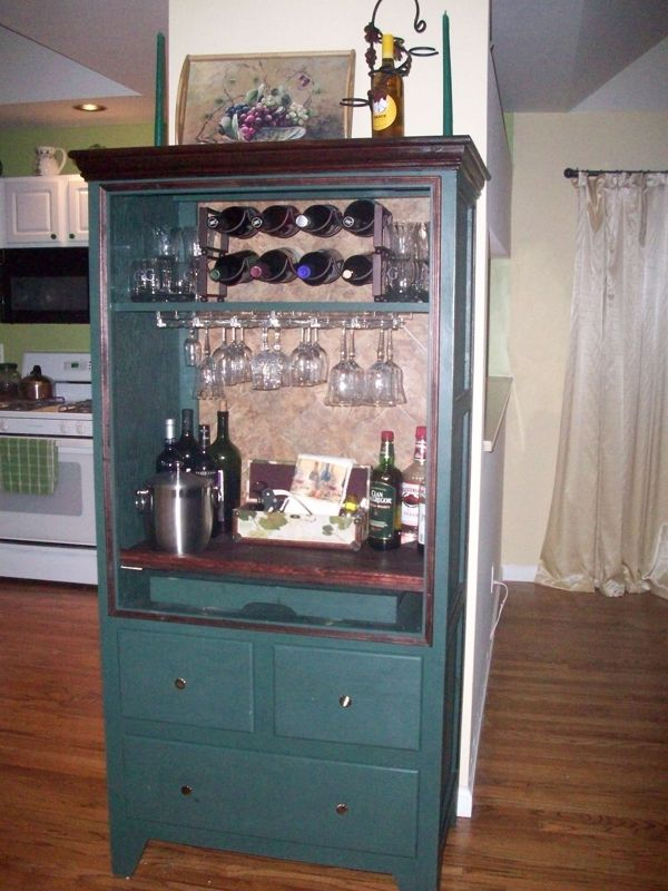 Old armoire used for big TV transformed into a bar. Removed two large front doors, and adapted the interior. Work involved was minimal.... Great idea for dining room