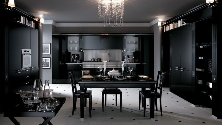 Baccarat Kitchen - design by Gianni Pareschi.  A new backdrop for the most ancient of traditions: this sums up Baccarat in black gloss lacquered version. A kitchen for classy interiors with unusual pillar fronts, bevelled plate glass, metal inserts, metal or methacrylate handles and boiserie panels.