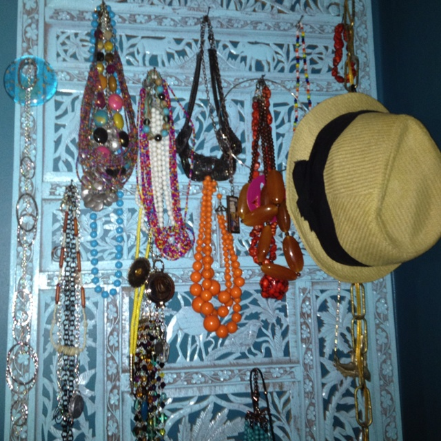 Room divider used to hang my necklaces and other essentials.