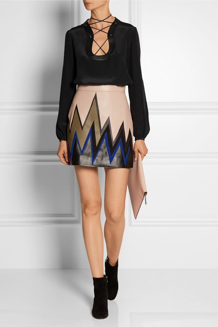 EMILIO PUCCI Lace-up leather-trimmed silk crepe de chine top $1,210|EDITORS' NOTES & DETAILS Emilio Pucci's fluid top has been crafted in Italy from black silk crepe de chine with smooth leather trims. It has a lace-up front that ties at the back of the neck for a halter-style effect. Underpin it with a U-Plunge bra for a seamless, no-show finish.