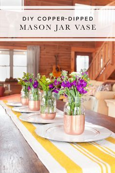 Are you looking for a charming and beautiful spring centerpiece for your next dinner party? These easy and super trendy DIY copper-dipped mason jar flower vases are the perfect choice.