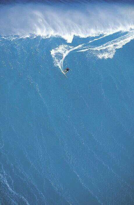 surfing massive wave