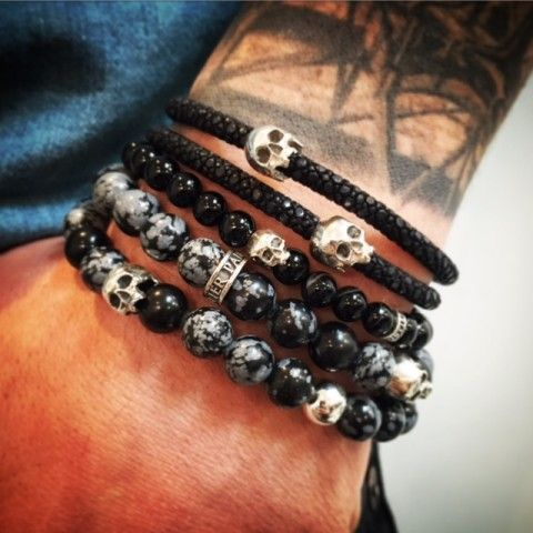 Stack of 3 elegant bracelets made in black tones by Flibustier Paris Made with gemstones, Stingray skin, leather and sterling silver and our emblematic skull