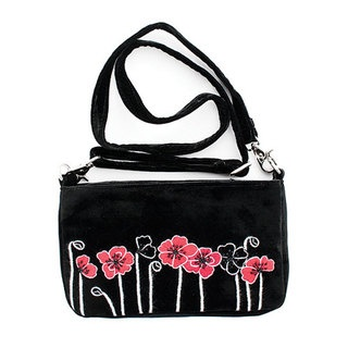 The new season Poppy design is fun, fresh and contemporary. Hand embroidered Poppy flowers are teamed with a gorgeous silk velvet outer and satin lining in a range of winter colours. With an internal zip pocket and cell phone pocket it safely holds everything you need for a night out.