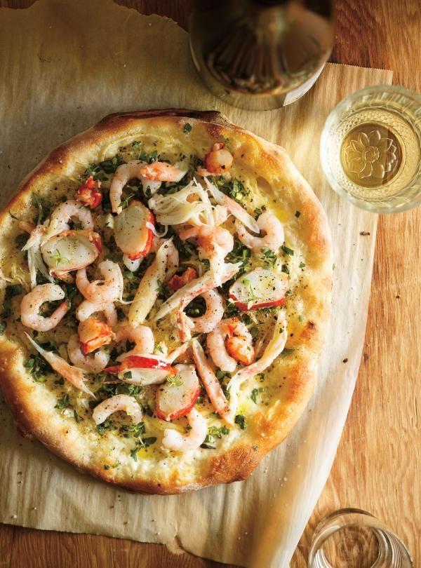 Recette de Ricardo de pizzas aux fruits de mer et aux herbes fraîches