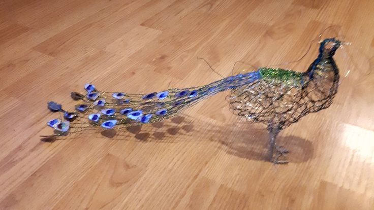 Wire peacock with wire nail varnish 'feathers'
