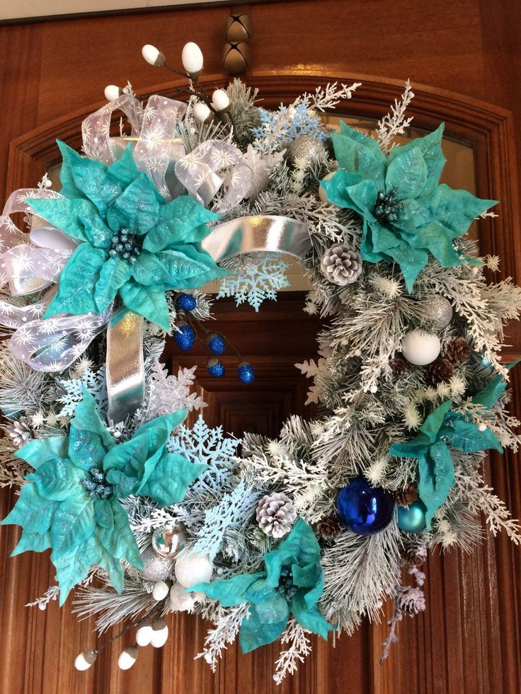 A personal favorite from my Etsy shop https://www.etsy.com/listing/478339310/giant-teal-poinsettia-christmas-wreath