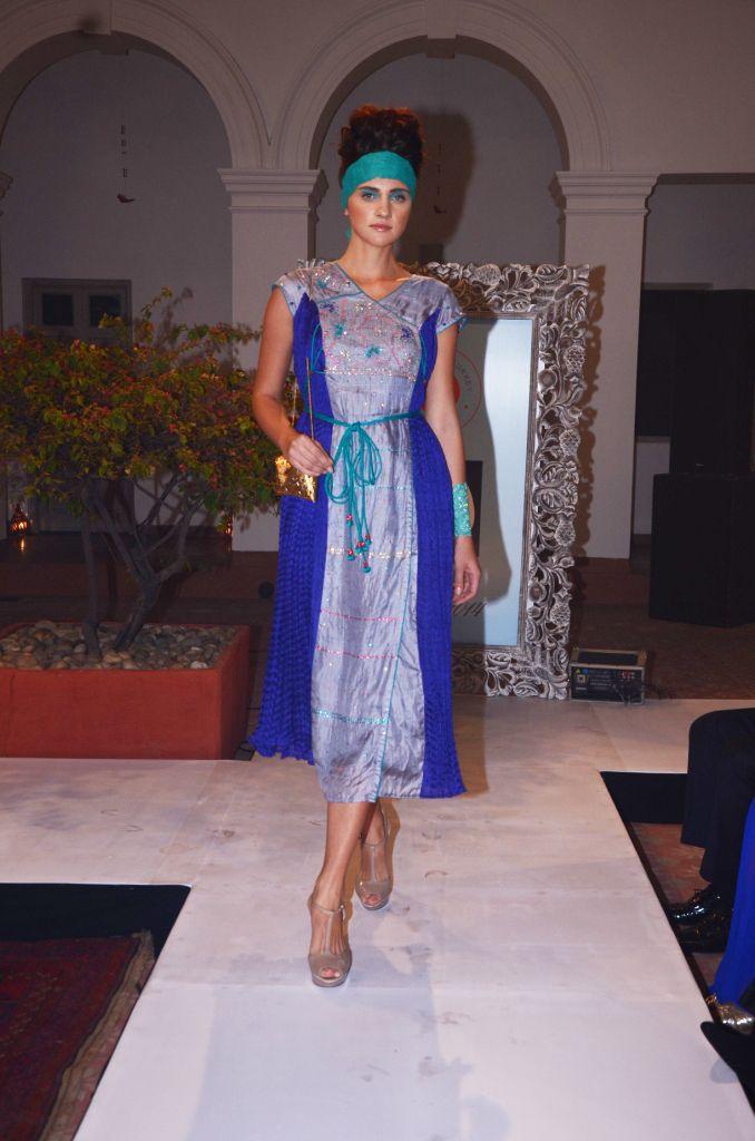 Grey tussar and ultra marine crinkled silk short kurta dress with a belt (INR 12,900)