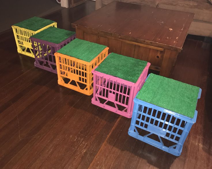 """Think outside the square you live in"". I transformed these old milk crates into colourful & cute seats for school aged children with fake grass for texture & comfort too."