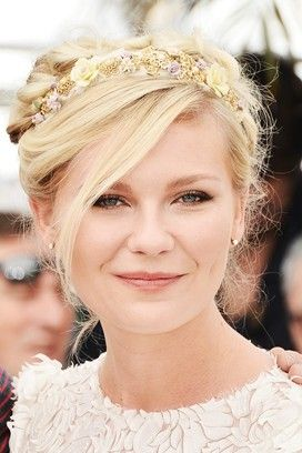 Kirsten Dunst wore her hair in a pretty up-do accessorised with a Dolce & Gabbana floral hairband at Cannes Film Festival 2012