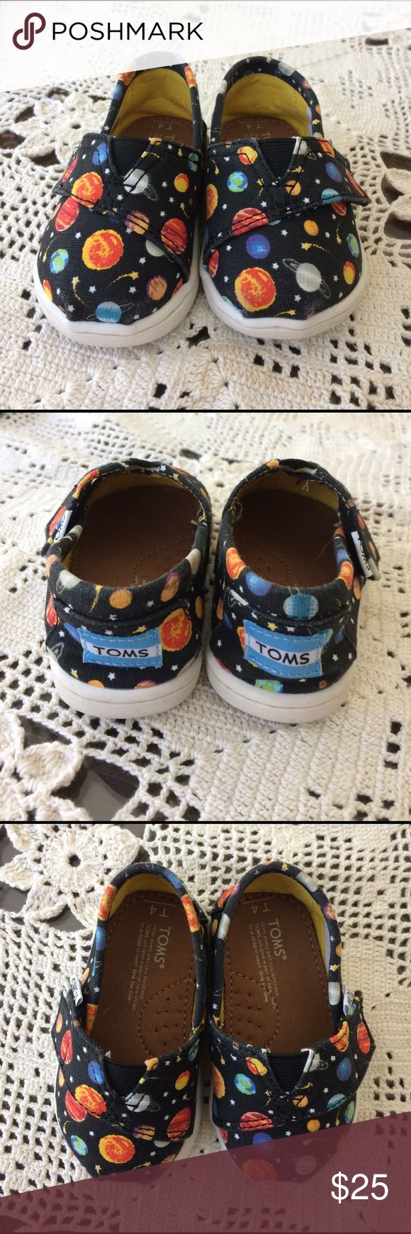 Toddler Boys Toms Planets Shoes Toddler Boys Toms canvas shoes in size 4. Planets and stars on a black background. They have Velcro on the side for easy access. These look like new. TOMS Shoes Sneakers