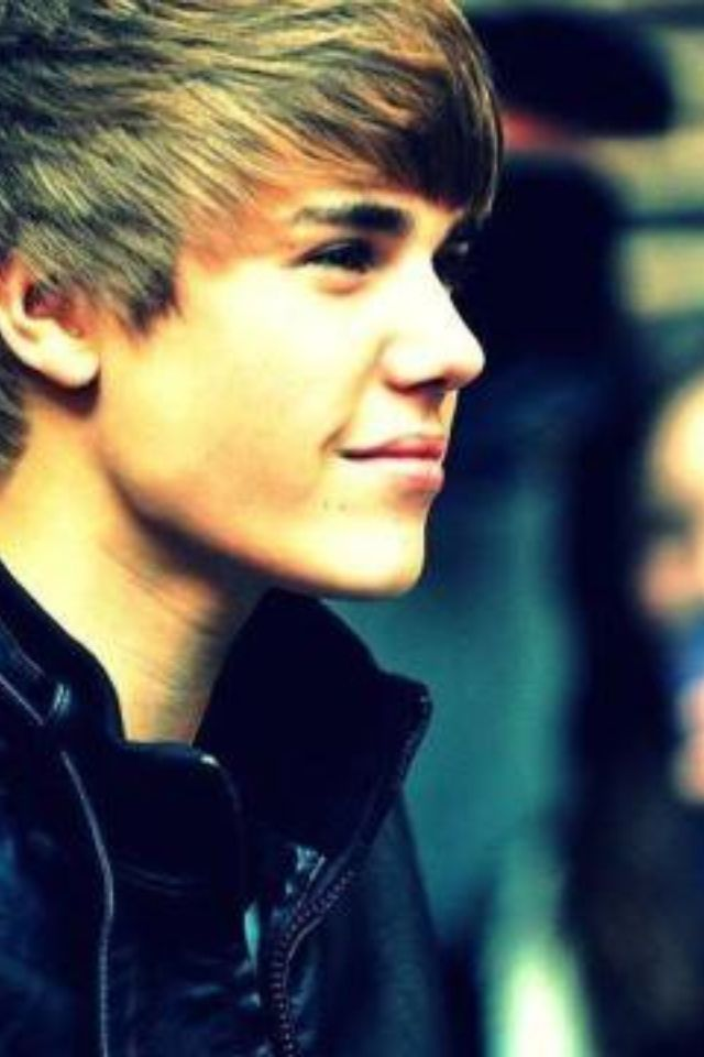 ok. ya can't say that's not a cute face. I don't know why everybody, in general, hates him. I think they are jealous. (;