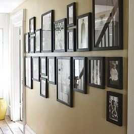 Great way to hang a bunch of differently-sized frames. Picture Collage
