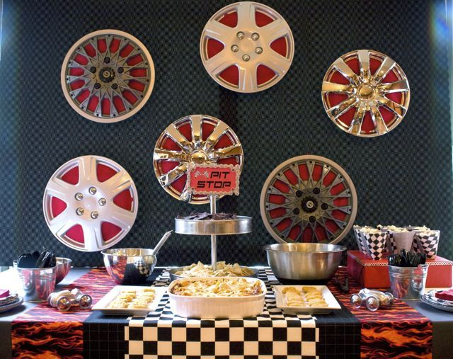 Hubcaps, Walmart 4 for $16. Especially good to decorate kids room afterwards. Chrome metal, fire fabric, checkered flag also comes in duct tape. Color palette- red, gray, black, white, orange