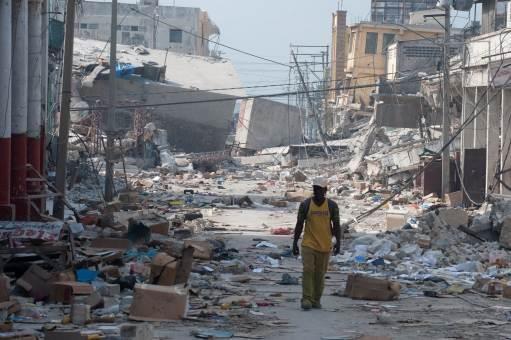 A single man walking through a ghost town