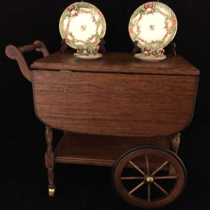 """Dollhouse Miniature Roger Gutheil Teacart & Teresa Welch China, Artist Signed =  teacart, by retired master craftsman Roger Gutheil, is 3"""" wide, 2-3/4"""" high and 1-5/8"""" deep w/leaves down. When the leaves are extended, the top measures 3-1/2"""" wide & 2-1/2 long. The piece features brass casters that roll. - Also two 3-piece place settings by Teresa """"Freeze"""" Welch. signed  work as  dinner plates are 7/8"""" saucer/teacups are approximately 3/8"""" Z"""