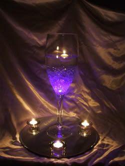 wedding reception centerpieces using glasses | ... lights!! [justme&him] - JUSTMEANDHIM's Purple Wedding by Color Blog