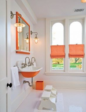 Orange White Bathroom.  Trough Sink.  Penny Tiles
