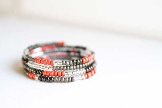 This pretty grey, coral, black and clear beaded bracelet is made with memory wire, it will adjust to the size of your wrist. Ladies bracelet measures