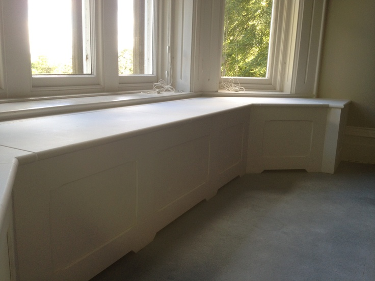 Window seat with hinged tops - great for storage. Custom made by Wild Wood Joinery
