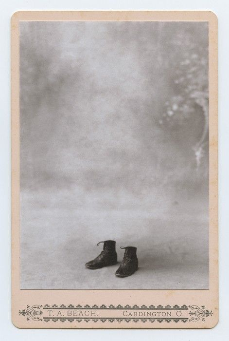 Portrait of two shoes. Found photo. greg sand