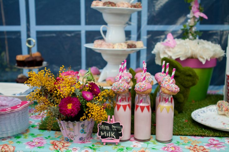 strawberry milk with donuts in retro jars and blackboard sign - Garden party table setting (cake table/dessert table/lolly bar) for my daughter Maya's first birthday (styled by Leah Bischoff)