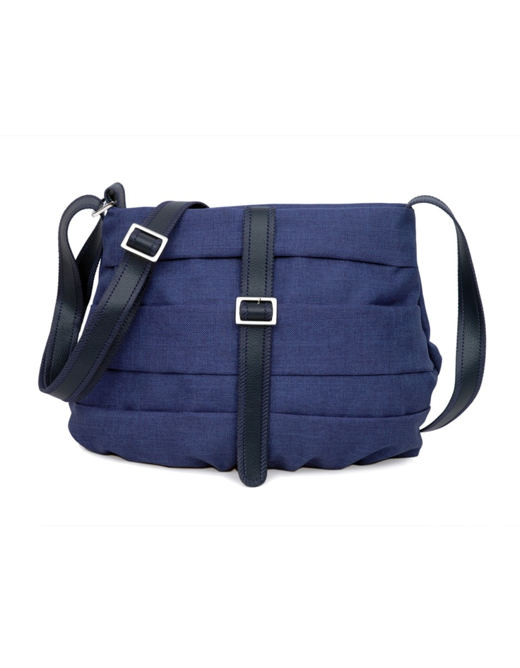 A vertical pleat accentuated sling by Baggit in a shade of blue.