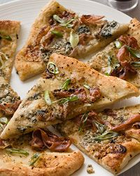 Fig-and-Prosciutto Flatbreads   This flatbread is topped with sticky-sweet fig jam, pungent Gorgonzola cheese and salty prosciutto.