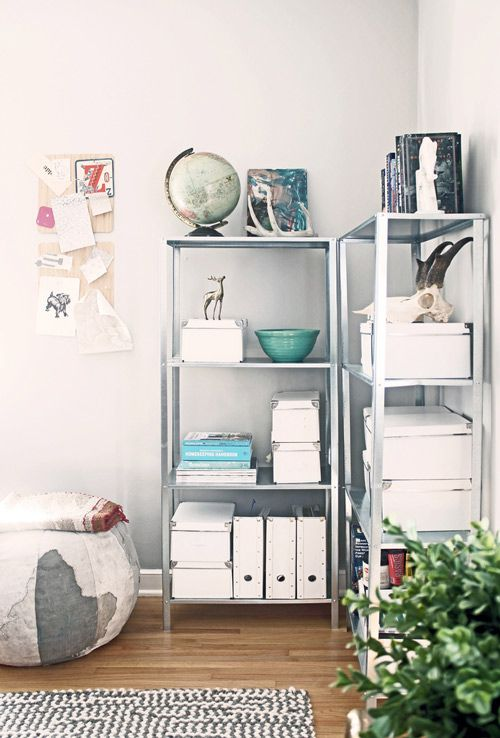 "Carla Fahden's office: ""The shelving units were $15 each from Ikea (score!). I'm a bit of a, um, Type A . . . I'm organized to a fault. The globe pouf is from Urban Outfitters."""