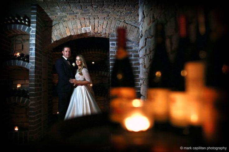 Bride & groom in wine cellar of Kilronan Castle wedding photographer kilronan