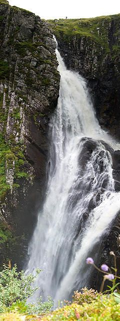 Falls of Glomach, in Ross-shire, Scotland, is one of highest waterfalls in Britain, @ 370'. It is not easily reached on foot, requiring a 5-mi trek through remote & wild countryside