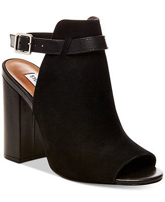 Fashionable block heel styling pairs with an ankle strap design in Steve Madden's contemporary, cutout Carnabi shooties.   Nubuck leather upper; manmade sole   Imported   Almond peep-toe slip-on sling