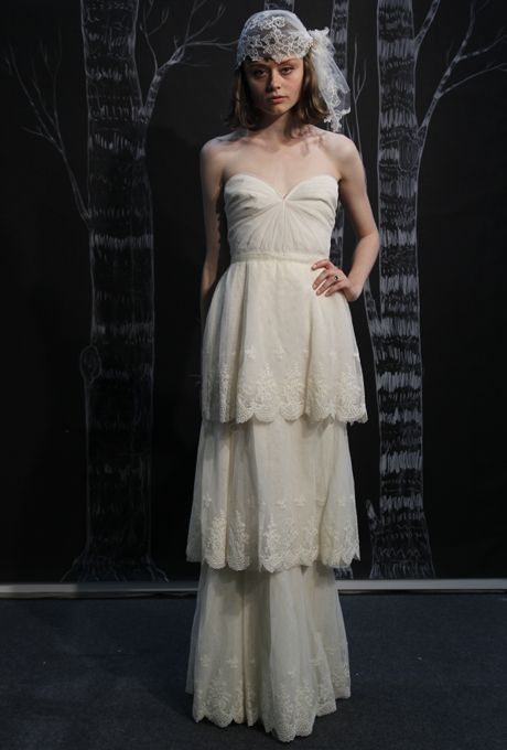 Structured tiers add drama to this wedding dress from Sarah Seven's spring 2013 collection