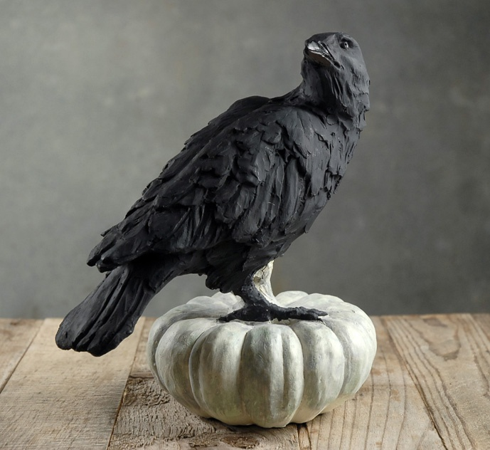 raven on a white pumpkin statue - Raven Halloween Decorations