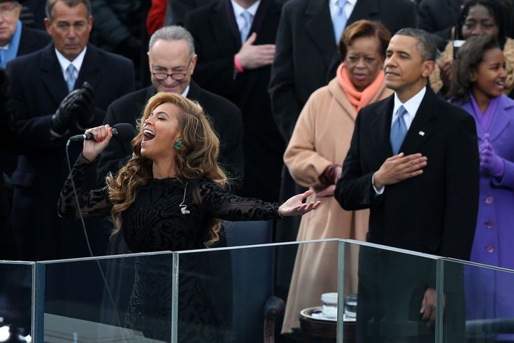 Beyoncé performs the national anthem as U.S. President Barack Obama looks on during the presidential inauguration on the West Front of the U.S. Capitol January 21, 2013 in Washington, DC.  Barack Obama was re-elected for a second term as President of the United States.  Or would the lack of them coincide