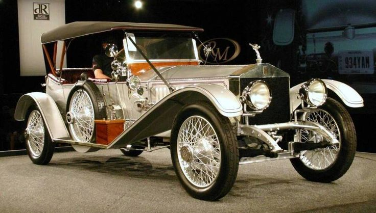 "1915 Rolls Royce Silver Ghost - This car has a 40/50 hp, 7,428 cc L-head six-cylinder engine, four-speed manual transmission, solid front axle, semi-elliptic leaf springs, live rear axle with cantilever leaf spring platform suspension, two-wheel mechanical brakes. Wheelbase: 143"". When I was a kid I thought all Silver Ghosts were called that name because they were silver....when I see the beauty of this car I think that should have been true."