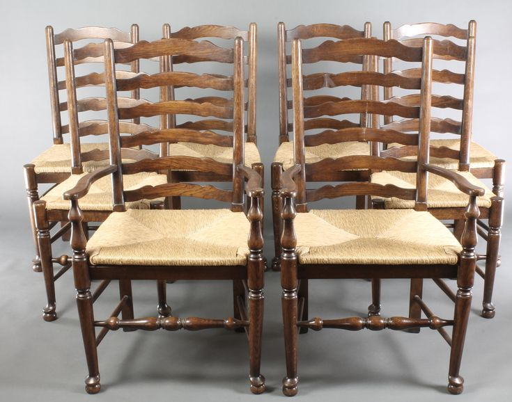 Lot 904, A set of 8 (2 and 6) elm ladder back dining chairs with woven rush seats, raised on turned supports with box framed stretcher, est £300-500