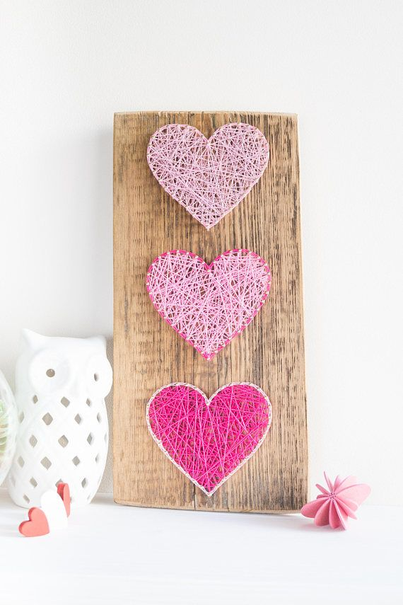 Modern Pink Heart String Art Wall Decor for minimalist, Scandinavian style interiors, great gift for friends, weddings and newlyweds. This simple yet elegant pink heart decor made on reclaimed greenhouse wood plank will lighten up any interior it is placed in. It Han be easily hanged vertically using one brass hanger on the backside of the wood base which has been made from reclaimed wood plank and has this great rustic vibe to it. Dont want to hang it - no problems just place it on a shelf…