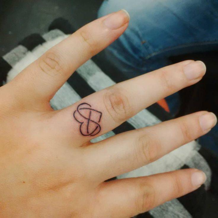 tattoo 9 an infinity eternity symbol heart on my wedding ring finger