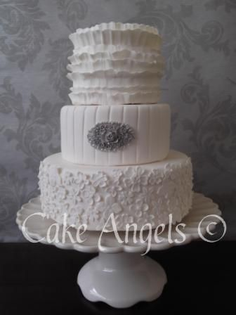 Cream Vintage Ruffle Wedding Cake with Silver Brooch detail