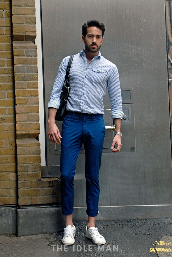 Men's street style Smart Casual - Got an event coming up and you're not sure what to wear? Smart casual is always a safe bet. Wear navy trousers with a checked shirt and a pair of white trainers. Shop the look at The Idle Man