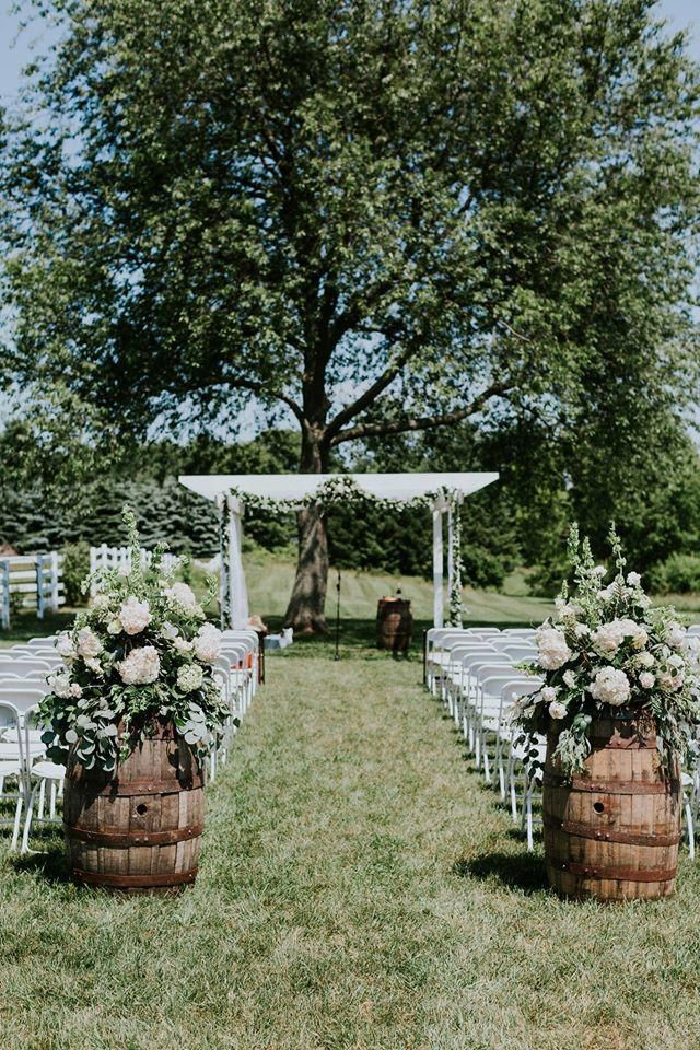 outdoor arbor garland and floral Amazing Floral Moments #Outdoorweddingphotograp…