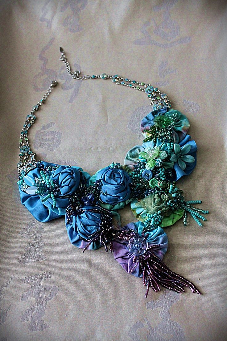 Necklace |  Carla S Fox.  'Love is Blue'  Vintage batik fabric yoyos, blue silk taffeta rosettes, seed beads, vintage jewelry bits and pieces, antique and vintage buttons.