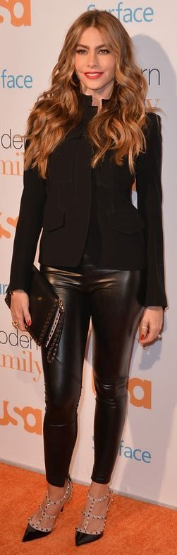 Black studded clutch handbag and nude pumps